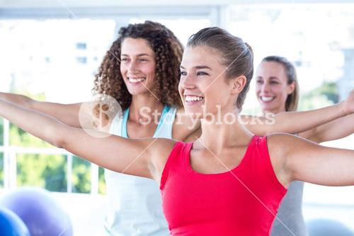 Cheerful women with arms outstretched