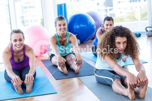 Woman sitting in forward bend pose