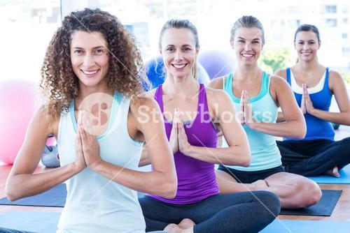 Portrait of women doing easy pose with hands joined