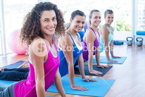 Portrait of women doing cobra pose