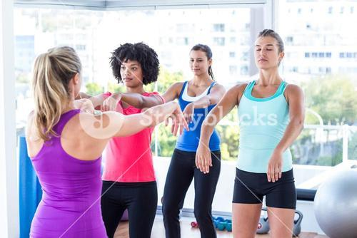 Instructor demonstrating exercise to women