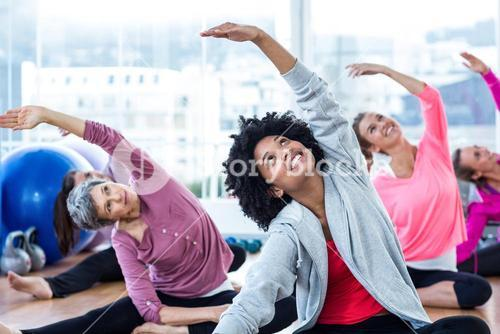 Happy women exercising while arms raised
