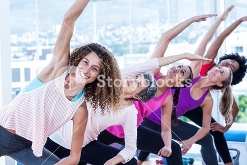 Smiling women bending with arms raised