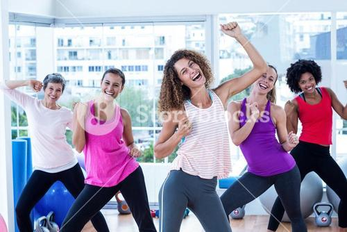 Portrait of women exercising with clasped hands