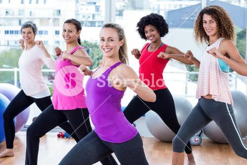Portrait of women exercising with clasped hands and stretching