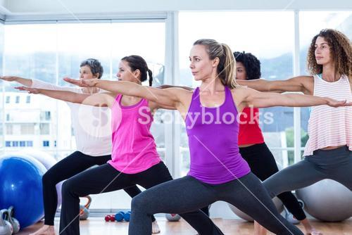 Women exercising with arms outstretched