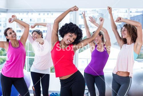 women exercising with arms raised