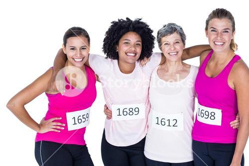 Portrait of happy female athletes with arms around