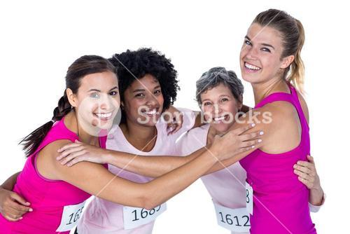 Portrait of happy athletes with arms around