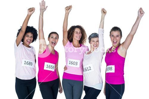 Cheerful athletes with arms raised