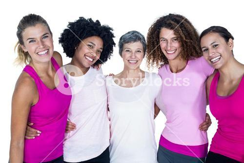 Portrait of smiling women with arms around