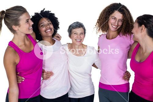 Smiling women with arms around