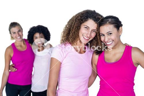 Portrait of happy women with arms around