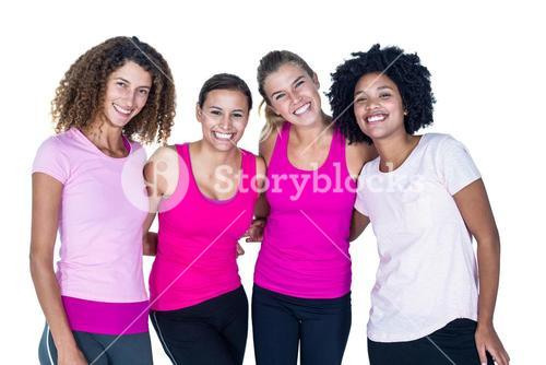 Portrait of smiling group of women with arms around