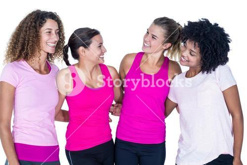 Smiling group of women with arms around