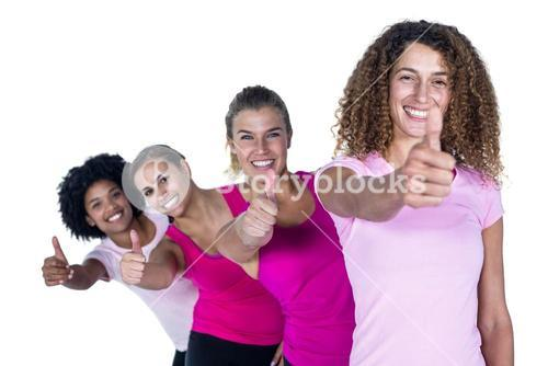 Portrait of smiling women with thumbs up