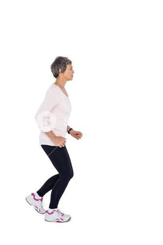 Side view of mature woman jogging