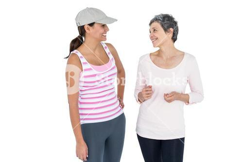 Happy fit women discussing