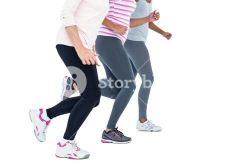 Low section of women jogging