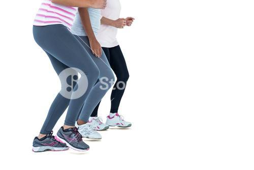 Low section of female friends jogging
