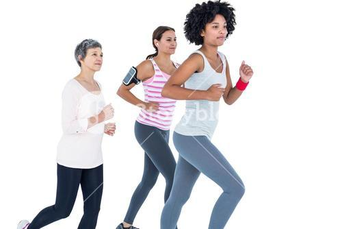 Determined female friends jogging