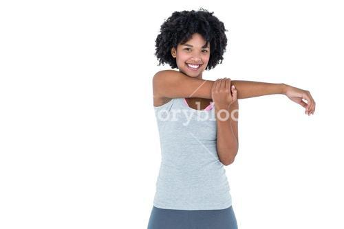 Portrait of cheerful woman exercising