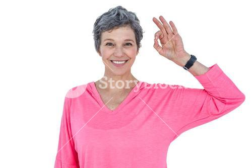 Happy mature woman showing OK sign