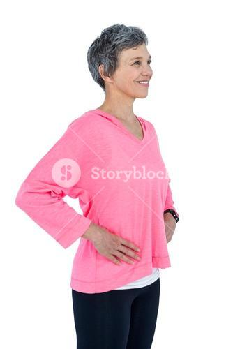 Happy mature woman with hand on hip