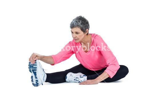 Fit mature woman exercising
