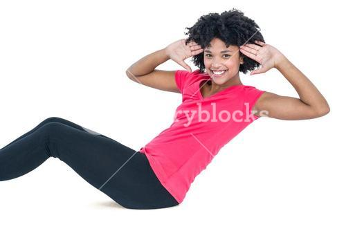 Portrait of young woman doing sit ups
