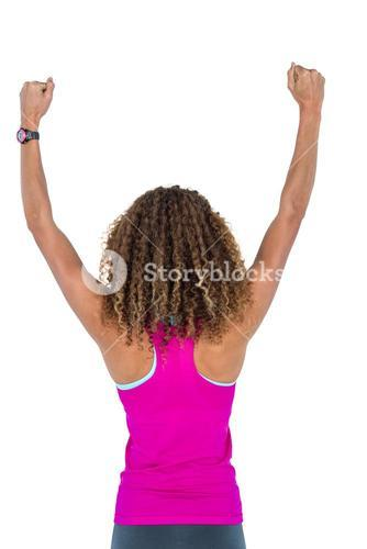 Rear view of woman cheering with arms raised
