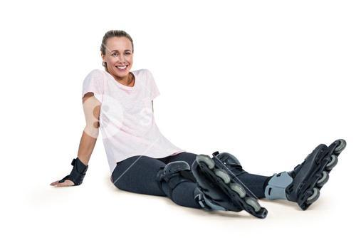Portrait of happy female inline skater relaxing