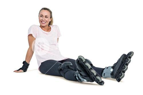 Happy female inline skater relaxing