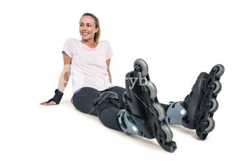 Cheerful female inline skater relaxing