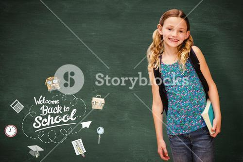 Composite image of cute little girl holding book in library