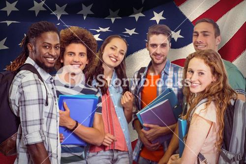 Composite image of smiling group of students holding folders