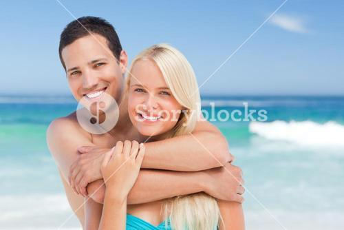Lovely couple against the sea