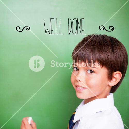 Well-done! against cute pupil holding chalk