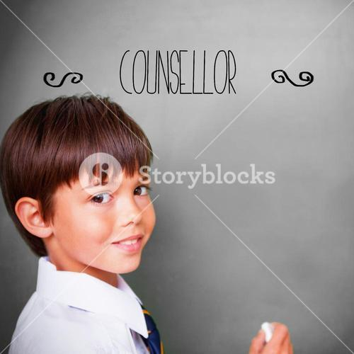 Counsellor against cute pupil with chalkboard
