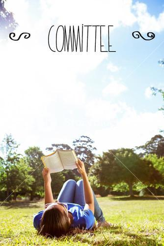 Committee against pretty woman reading in the park