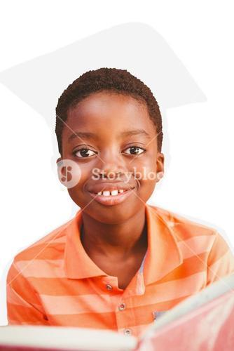 Composite image of cute boy reading book in library