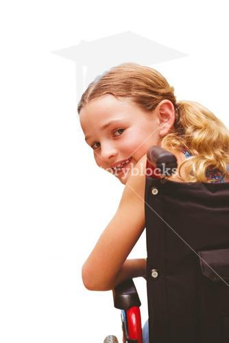 Composite image of portrait of cute girl sitting in wheelchair