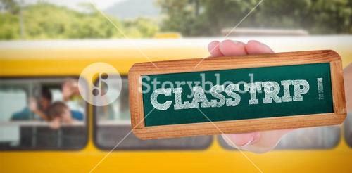 Class trip! against cute pupils smiling at camera in the school bus