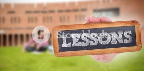 Lessons against students using laptop in lawn against college building