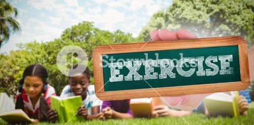Exercise against children lying on grass and reading books