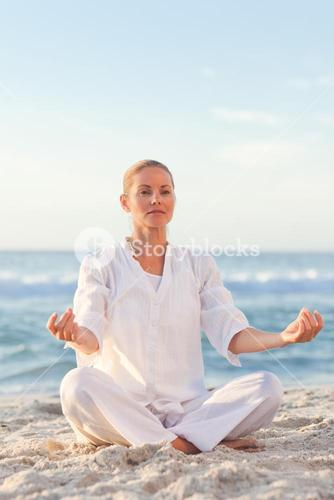 Peaceful woman practicing yoga