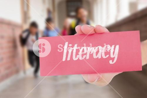 Literacy against teacher helping pupils in library
