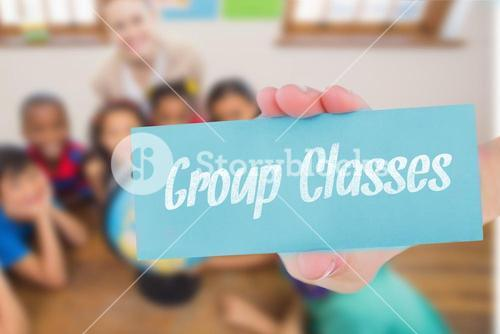 Group classes against cute pupils and teacher in classroom with globe