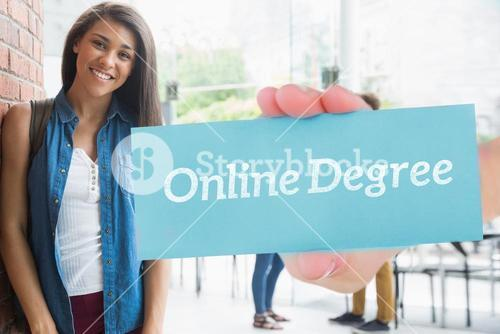 Online degree against pretty student smiling at camera with classmates behind