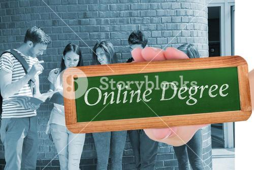 Online degree against happy students standing and reading